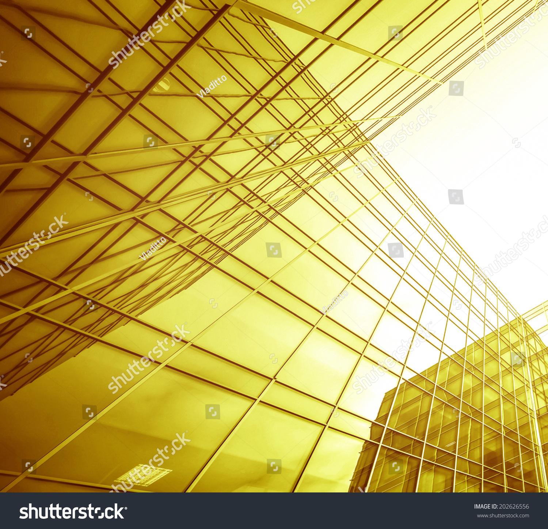 全景和广角透视视图钢淡黄色背景的玻璃摩天大楼高层.