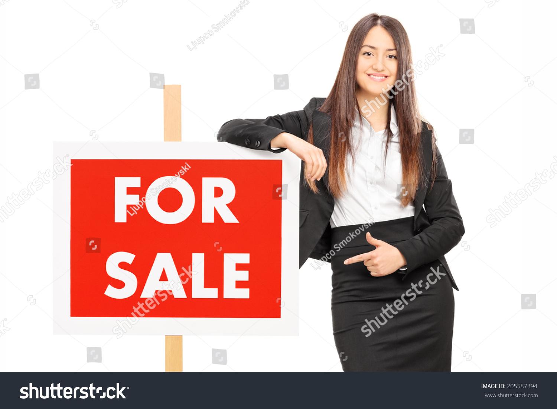指向一个面板孤立在白色背景的女人-商业/金融,人物