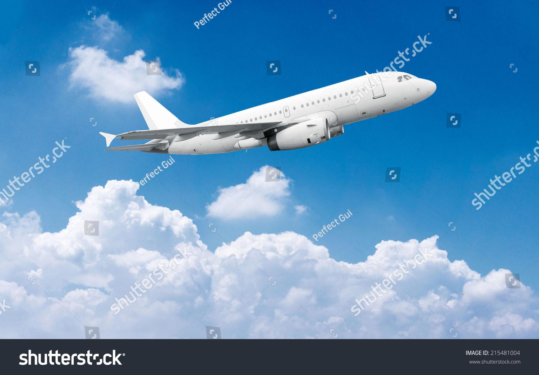 民航飞机飞行在蓝色的天空-交通运输,自然-海洛创意()