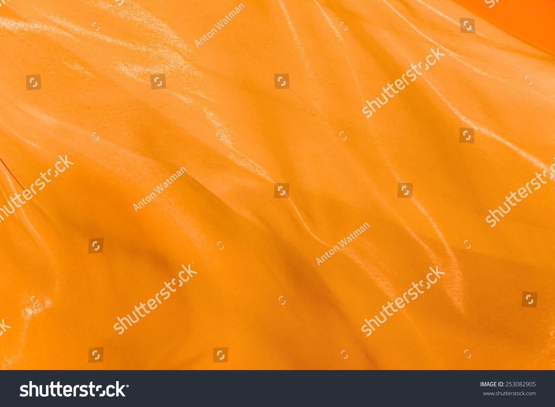 橙色的折叠丝织品在风中飘扬-背景/素材,抽象-海洛()图片