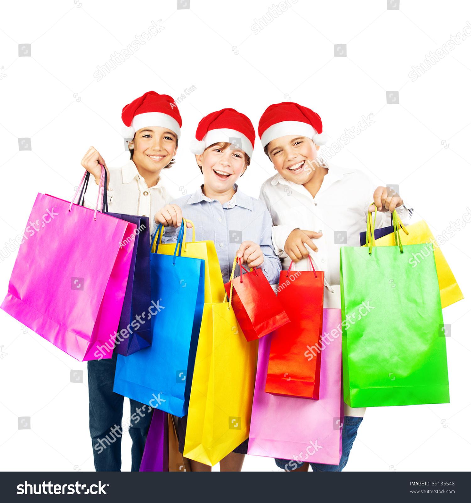 男孩快乐的圣诞礼物,孩子们携带着丰富多彩的购物袋